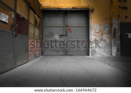 old industrial iron door, a machine factory - stock photo