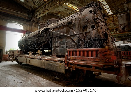 Old industrial locomotive in the garage abandoned