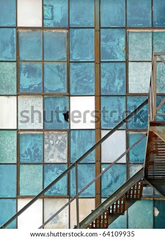 Old industrial window and fire escape abstract - stock photo