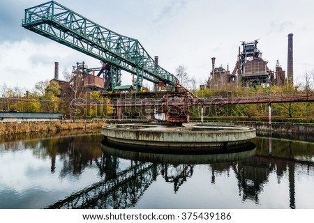 Old industry building at the Landschaftspark Duisburg, a former coal and steel production plant abandoned in 1985 and converted into an industrial monument open for the public in 1991.  - stock photo