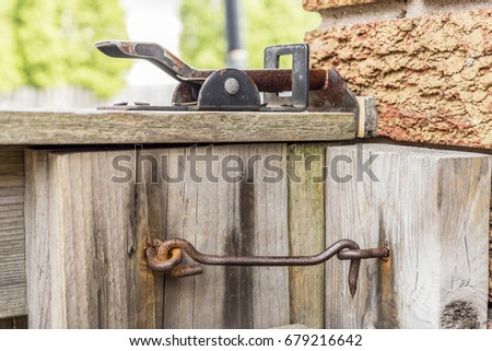 Old Ineffective Rusty Latches On Wooden Gate To Backyard, Closeup, Security  Concept