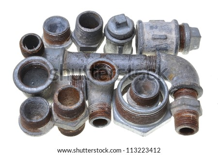 Old installations, iron pipe fittings for plumbing - stock photo