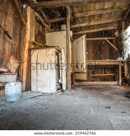 old interior of abandoned shed with fridges  - stock photo