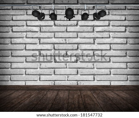 Old interior room with brick wall and spots light  - stock photo
