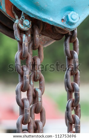 Old iron chain tie on the metal bar. - stock photo