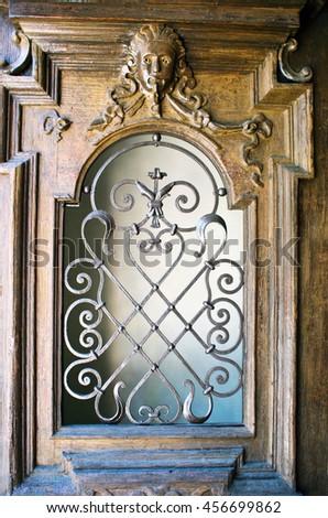 Old iron door with key-stone - stock photo