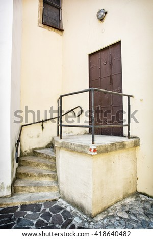 Old iron gate with railing and staircase to the church. Trencin, Slovak republic. Religious architecture. Architectural element. - stock photo