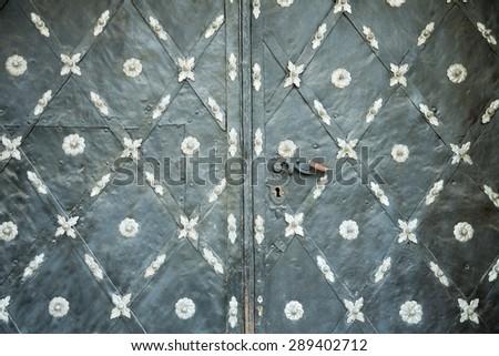 old iron gray door as background - stock photo