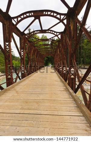 Old iron railway bridge near Kranjska gora converted to cyclists and pedestrians, Slovenia - stock photo