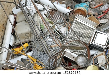 old irons left in a landfill hazardous metals and abusive rusted - stock photo