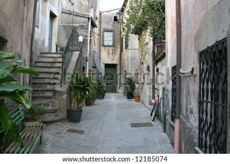 old italian courtyard leading to homes