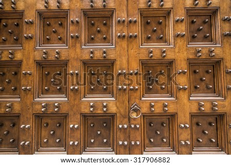 Old Italian wooden door with metal pins