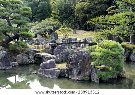Old Japanese garden of Nijo Castle in Kyoto, Japan - stock photo