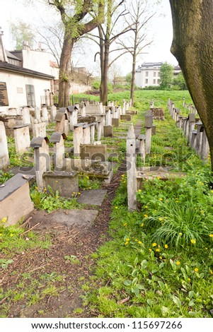 Old Jewish cemetery is located beside the Remuh Synagogue at 40 Szeroka Street in the historic Kazimierz district of Krak���³w. - stock photo