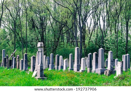 old jewish tombs on cemetery image - stock photo