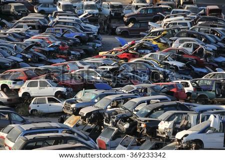 Old Junk Cars On Junkyard - stock photo