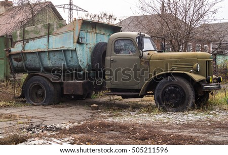 Old junk truck standing on the street