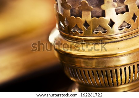 old kerosene lamp next to an old mirror - stock photo