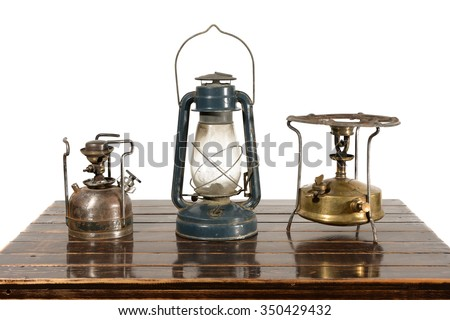Old kerosene lantern, kerosene stove burner and gasoline. The equipment has withdrawn from use.