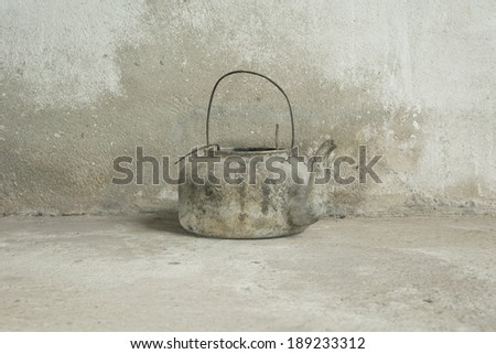 Old kettle in the old background