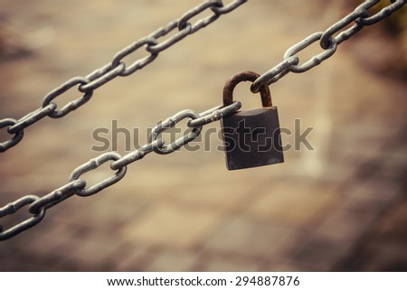 old key lock locked with a chain - stock photo