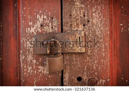 Old key lock on  wooden door - stock photo