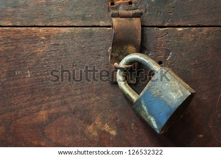 Old key lock on wooden wall - stock photo