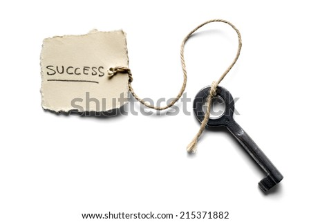 old key to success concept with label or tag - stock photo
