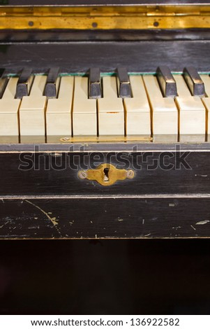 old keyboard of vintage black piano - stock photo