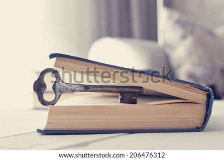 Old keys in the book - stock photo