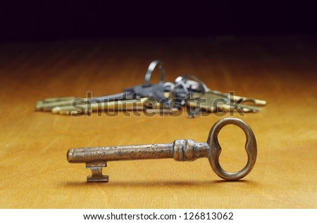 Old keys on a wooden table