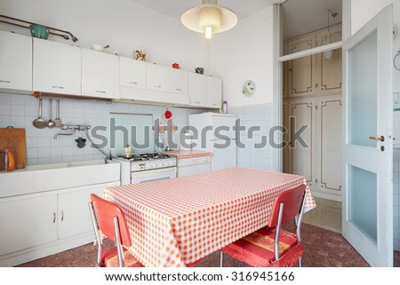 Old kitchen interior in normal house - stock photo