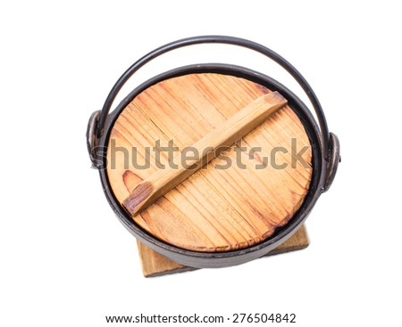 Old kitchen metal pot with wooden cap. Isolated on a white background.