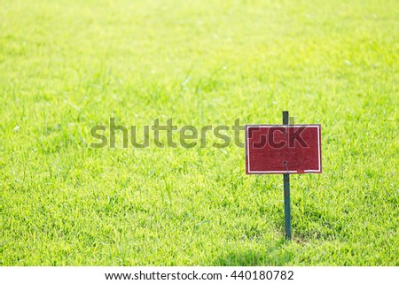 Old label against green grass background.