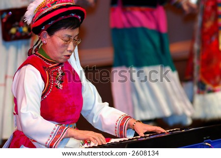 Old Lady Perform on the Keyboard