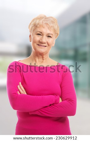 Old lady's portrait in pink casual clothes - stock photo