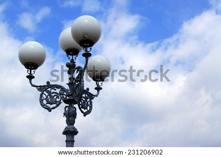 Old lamp against the sky - stock photo