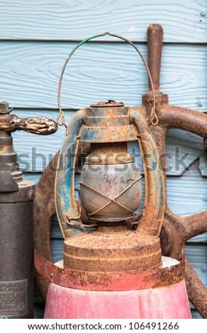 Old lamp, Hurricane lamp/storm lantern; very corroded vintage kerosene lamp; - stock photo