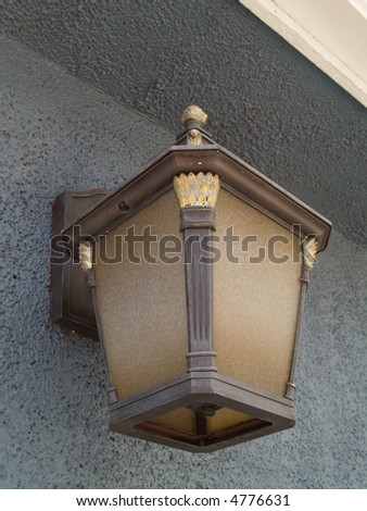 old lamp on a wall - stock photo