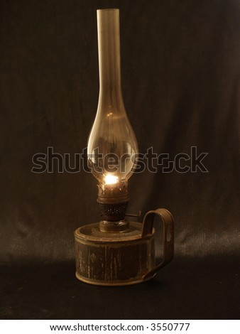 Old lamp smoldering in the darkness - stock photo