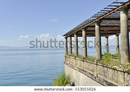 old landing stage with pillars on the lake