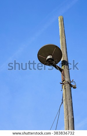 old lantern on the roadside - stock photo