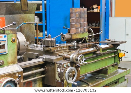 Old lathe in workshop of the plant - stock photo