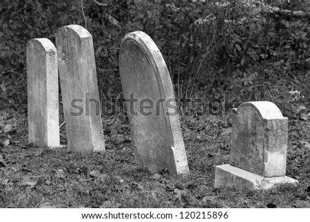 Old leaning tombstones in a row.