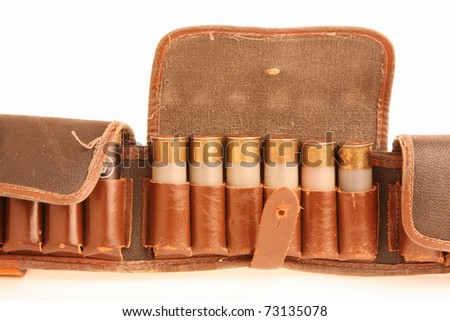 Old leather bandoleer on a white background - stock photo