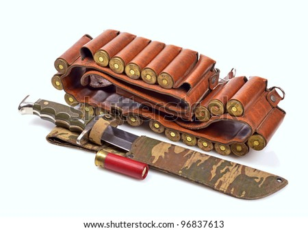 Old leather bandolier, ?ld hunting knife ,on a white background - stock photo