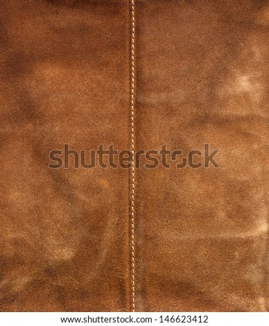 Old Leather Brown Background / Old brown used leather with center seam - stock photo