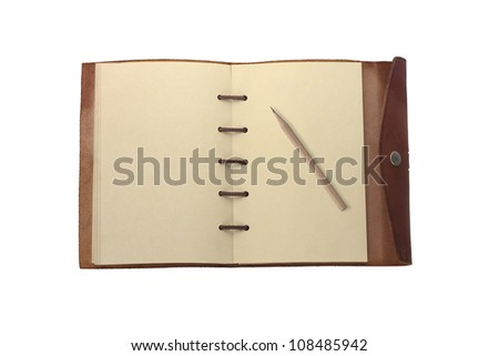 Old leather cover book with pencil - stock photo