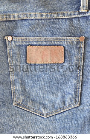 old leather jeans label sewed on jeans.