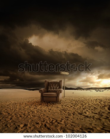 Old leather seat abandoned in the desert and arrow indicates the hop - stock photo